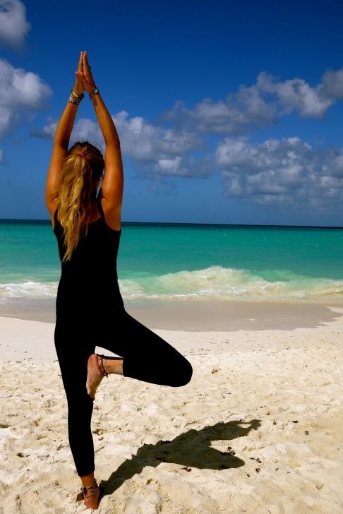 easy yoga poses on the beach image